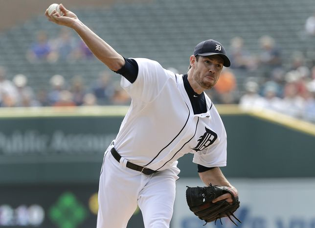 FILE - In this Sept. 19, 2013, file photo, Detroit Tigers starting pitcher Doug Fister throws against the Seattle Mariners during a baseball game in Detroit. The Tigers have traded Fister to the Washington Nationals for three