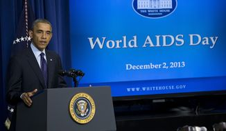 **FILE** President Obama gestures while speaking at a world AIDS Day event on Dec. 2, 2013, in the South Court Auditorium on the White House complex in Washington. (Associated Press)