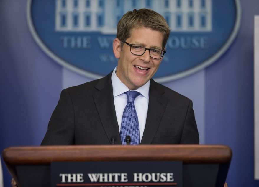 White House press secretary Jay Carney answers a question during the daily press briefing, Monday, Dec. 2, 2013, in the White House briefing room in Washington. Carney answered questions on the ongoing rollout of the Healthcare.gov website. (AP Photo/ Evan Vucci)