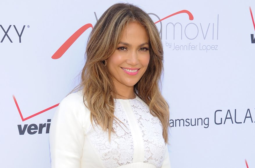 """** FILE ** This July 26, 2013, file photo shows singer and actress Jennifer Lopez at the """"Viva Movil by Jennifer Lopez"""" flagship store grand opening in the Brooklyn borough of New York. Lopez, the 44-year-old mother of 5-year-old twins, Maximilian and Emme, will receive the Grace Kelly Award at the March of Dimes luncheon at the Beverly Hills Hotel on Friday, Dec. 6, 2013. (Photo by Evan Agostini/Invision/AP, File)"""
