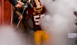 Smoke surrounds Washington Redskins inside linebacker London Fletcher (59) as he waits to be announced before  the Washington Redskins play the New York Giants in Sunday Night Football at FedExField, Landover, Md., Sunday, December 1, 2013. (Andrew Harnik/The Washington Times)