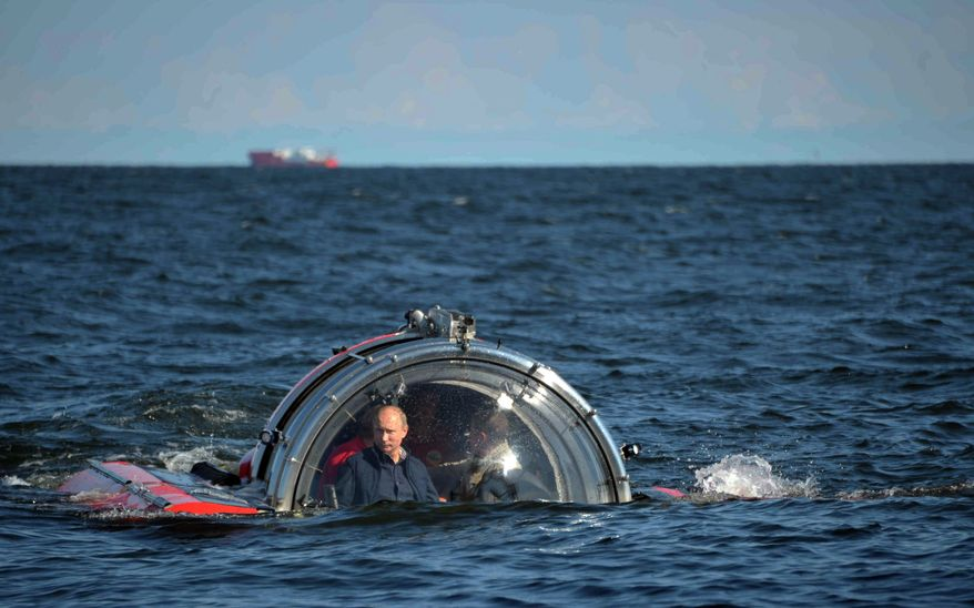 FOR USE AS DESIRED, YEAR END PHOTOS - FILE - Russian President Vladimir Putin submerges on board Sea Explorer 5 bathyscaphe off the island of Gogland 180 kilometers (110 miles) west of St. Petersburg, Russia, Monday, July 15, 2013. Putin rode a small submersible craft 60 meters (200 feet) down to see the remains of the naval frigate Oleg, which sank in 1869.  (AP Photo/RIA-Novosti, Alexei Nikolsky, Presidential Press Service, File)