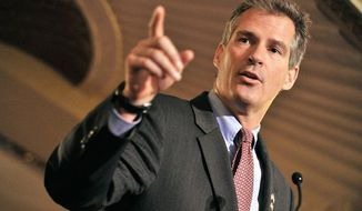 ** FILE ** Is former Massachusetts Sen. Scott P. Brown planning to run for U.S. Senate in New Hampshire? Looks like it. The Granite State Republican Party has asked him to be the host at its Christmas party. Sen. Jeanne Shaheen, a Democrat, currently holds the seat. (Associated Press)