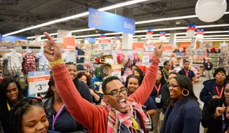 """Merchandise supervisor Ke'lley Howard leads employees in a """"Wal-Mart cheer"""" Tuesday at the Wal-Mart store on H Street in Northwest, a day before the store opens. Merchandise supervisor Ke'lley Howard leads a """"Wal-Mart Cheer"""" with his fellow employees the day before Walmart opens their doors for the first time at 99 H Street N.W., Washington, D.C., Tuesday, December 3, 2013. (Andrew Harnik/The Washington Times) (andrew harnik/the washington times)"""