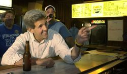 Democratic presidential nominee Sen. John Kerry, D-Mass., drinks a beer while visiting with locals at Abdalla's Tavern in Stratton, Ohio on Saturday, Sept. 4, 2004. (AP Photo/Laura Rauch)