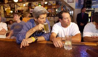 ** FILE ** Democratic Presidential candidate Sen. John Kerry, D-Mass, has a beer inside The Main Street Pub and Grill in Mount Horeb, Wisc. September 26, 2004. (AP Photo/Gerald Herbert)