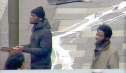 In this photo made from CCTV and released by the Metropolitan Police on Tuesday, Dec. 3, 2013,  Michael Adebolajo and Michael Adebowale  speak to a member of the public near to the Woolwich Barracks in London in May 2013. The footage was shown in court during the trial of Michael Adebolajo, 28, and Michael Adebowale, 22, who stand accused of the murder of Fusilier Lee Rigby. (AP Photo / Metropolitan Police)