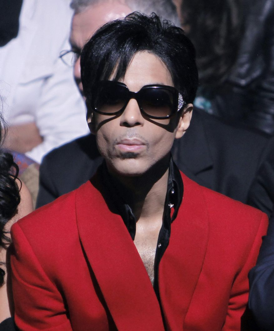 FILE - In this Oct. 7, 2009 file photo, U.S singer Prince attends John Galliano's Spring-Summer 2010 fashion collection, presented in Paris. Singer-songwriter Prince is headlining the 20th annual Essence Festival, a celebration of black music and culture being held July 3-6, 2014 in New Orleans. (AP Photo/Thibault Camus, File)