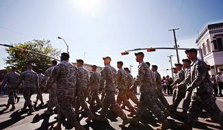 ** FILE ** Soldiers from Fort Hood march during the annual Veterans Day parade outside of Fort Hood in downtown Killeen, Texas, Nov. 11, 2009. (Associated Press)
