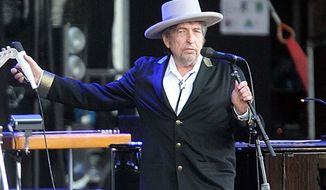 American singer-songwriter Bob Dylan performs at Les Vieilles Charrues festival in Carhaix, France, on July 22, 2012. French authorities have filed preliminary charges against Mr. Dylan over an interview in which he is quoted comparing Croatians to Nazis and the Ku Klux Klan. (AP Photo/David Vincent)
