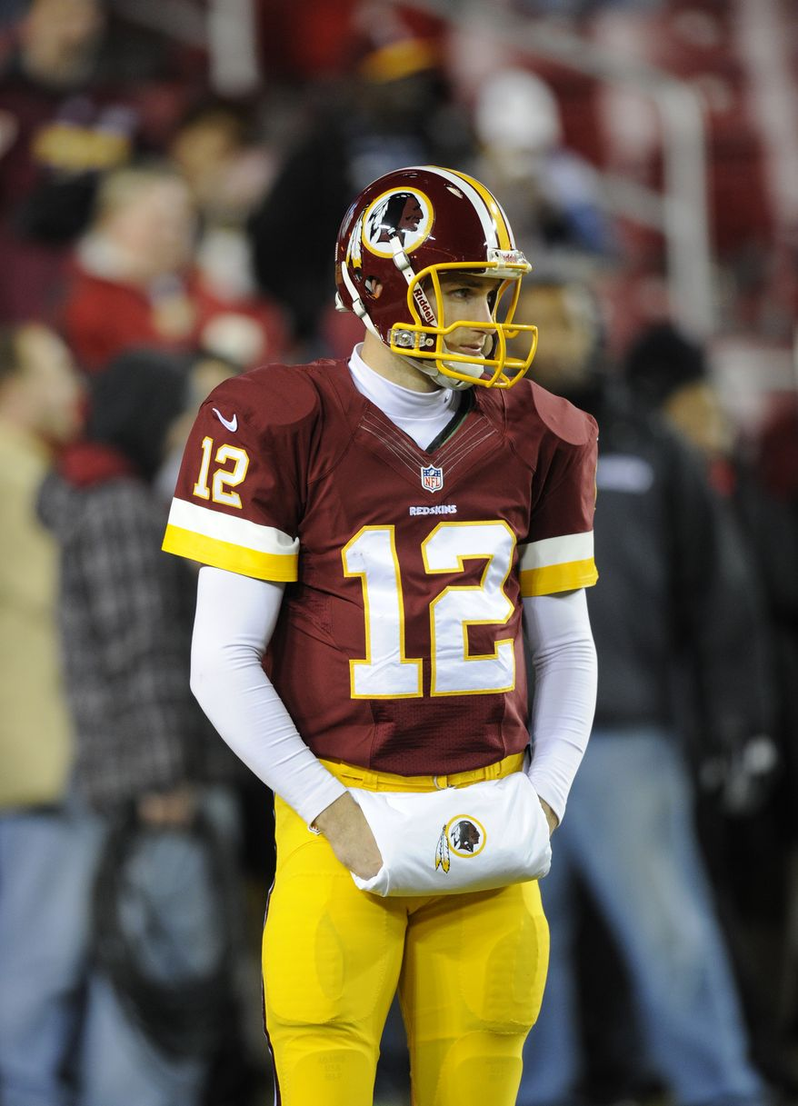 Washington Redskins quarterback Kirk Cousins (12) looks on before during an NFL football game against the New York Giants, Sunday, Dec. 1, 2013, in Landover, Md. (AP Photo/Nick Wass)