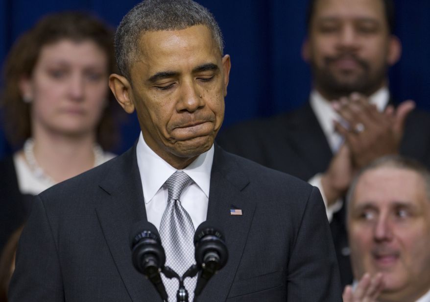 """President Barack Obama pauses as he speaks about the new health care law, Tuesday, Dec. 3, 2013, in the South Court Auditorium in the Eisenhower Executive Office Building on the White House complex in Washington. The president said his signature health care law """"is working and will work into the future."""" Obama said the benefits of the law have """"gotten lost"""" in recent months as attention focused on the widespread problems that crippled the website where people can sign up for health insurance. On stage with the president are Americans the White House says have gained as a result of the Affordable Care Act.  (AP Photo/Carolyn Kaster)"""