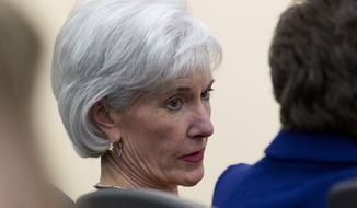 ** FILE ** Health and Human Services Secretary Kathleen Sebelius sits in the audience before President Barack Obama arrives to speak about the new health care law, Tuesday, Dec. 3, 2013, in the South Court Auditorium in the Eisenhower Executive Office Building on the White House complex in Washington. (AP Photo/Carolyn Kaster)
