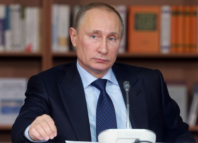 Russian President Vladimir Putin attends a meeting of the board of trustees in the Moscow State University in Moscow, Tuesday, Dec. 3, 2013. At a meeting with students in the Moscow State University Putin said  that Russia should beef up its presence in the Arctic