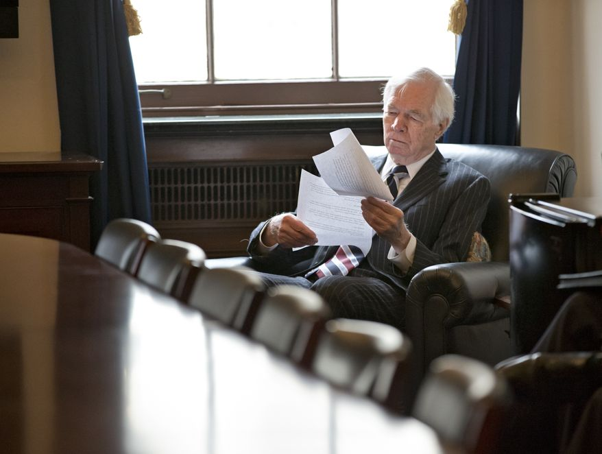 **FILE** Sen. Thad Cochran, Mississippi Republican and ranking member on the Senate Agriculture Committee, looks over documents before a closed-door meeting with other Farm Bill negotiators on Capitol Hill in Washington on Dec. 4, 2013. There is agreement on many parts of the legislation but significant differences remain over funding for the Supplemental Nutrition Assistance Program, more commonly known as food stamps. (Associated Press)