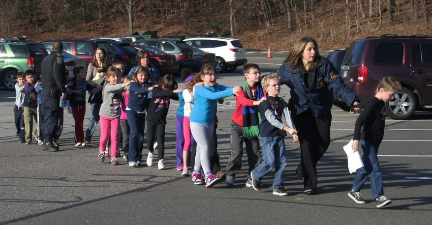 ** FILE ** In this photo provided by the Newtown Bee, Connecticut State Police lead a line of children from the Sandy Hook Elementary School in Newtown, Conn., on Friday, Dec. 14, 2012, after a shooting at the school.  Recordings of 911 calls from the Newtown school shooting are being released Wednesday Dec. 4, 2013, days after a state prosecutor dropped his fight to continue withholding them despite an order to provide them to The Associated Press. (AP Photo/Newtown Bee, Shannon Hicks, File)