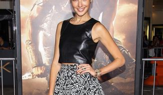 """Israeli actress Gal Gadot arrives for the world premiere of """"Riddick"""" at the Mann Village Westwood Theater in Los Angeles on Wednesday, Aug. 28, 2013. Miss Gadot has been cast as Wonder Woman in the Warner Bros. superhero team-up film with Batman and Superman. (Paul A. Hebert/Invision/AP)"""