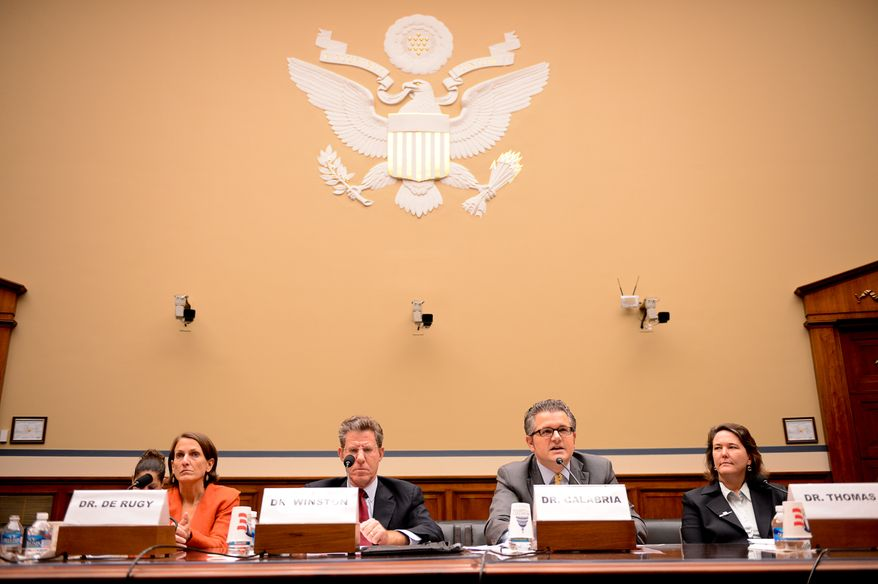 Left to right: George Mason University senior research fellow Dr. Veronique de Rugy, Brookings institution senior fellow Dr. Clifford Winston, Cato Institute Director of Financial Regulation Studies Dr. Mark Calabria, and Johns Hopkins public health historian and communications associate Dr. Karen Kruse Thomas appear before the House Oversight and Government Reform Committee for a hearing on the rollout of HealthCare.gov at the Rayburn Building on Capitol Hill, Washington, D.C., Wednesday, December 4, 2013. (Andrew Harnik/The Washington Times)