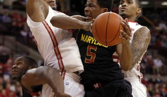 Maryland's Nick Faust (5) goes up for a shot against Ohio State's LaQuinton Ross, right, and Amir Williams as Maryland's Shaquille Cleare,rear left, helps during the first half of an NCAA college basketball game in Columbus, Ohio, Wednesday, Dec. 4, 2013. ( AP Photo/Paul Vernon)