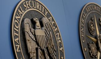 In this Thursday, June 6, 2013, file photo, a sign stands outside the National Security Administration (NSA) campus in Fort Meade, Md. (AP Photo/Patrick Semansky, File)