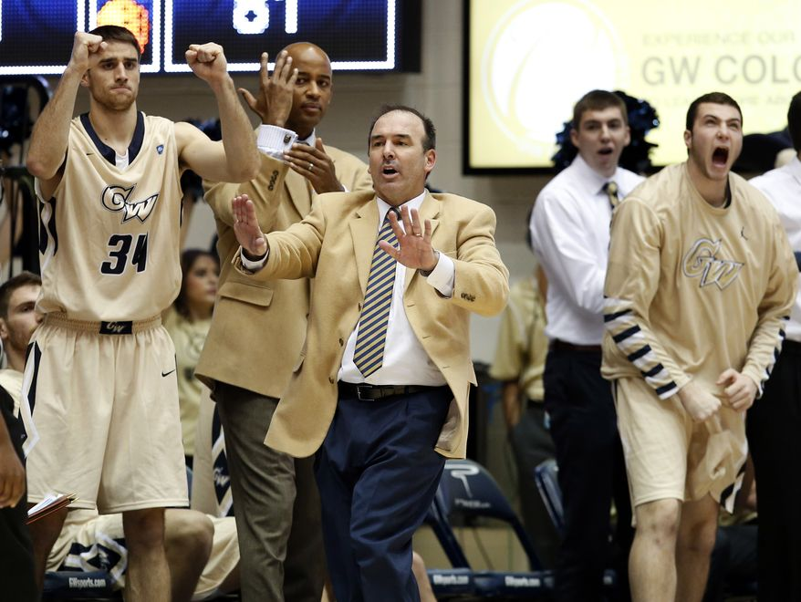 George Washington head coach Mike Lonergan, center, reacts with his team during the second half of an NCAA college basketball game against Rutgers, Wednesday, Dec. 4, 2013, in Washington. George Washington won 93-87. (AP Photo/Alex Brandon)