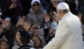 Pope Francis waves to faithful as he arrives in St. Peter's Square for the weekly general audience at the Vatican, Wednesday, Dec. 4, 2013. (AP Photo/Gregorio Borgia)