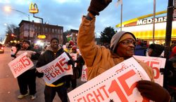 Demonstrators rally for better wages outside a McDonald's restaurant in Chicago on Thursday. Demonstrations planned in 100 cities were part of push to raise the federal minimum wage of $7.25. The effort produced a backlash. (ASSOCIATED PRESS)