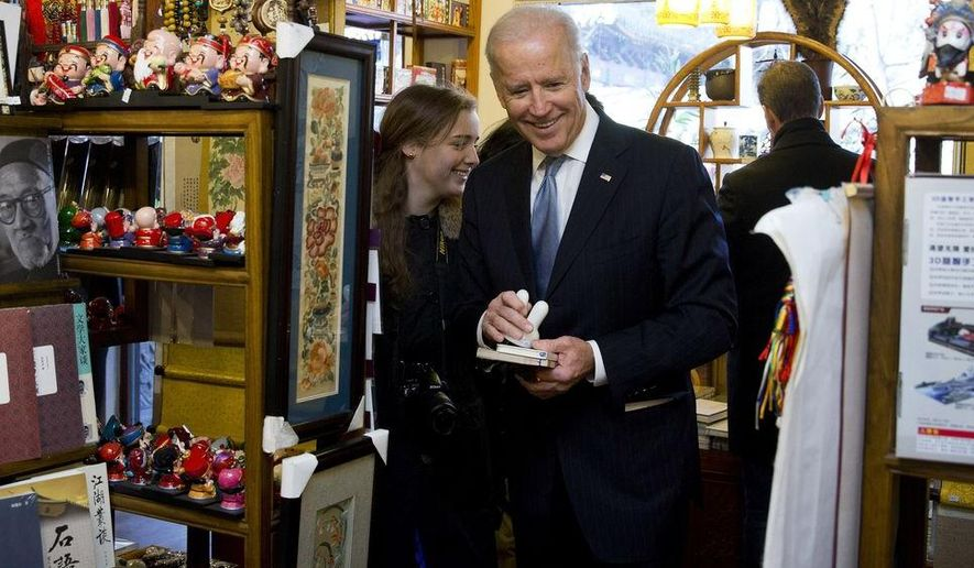 U.S. Vice President Joe Biden and his granddaughter Finnegan Biden shop at a bookstore in Beijing, China, Thursday, Dec. 5, 2013. (AP Photo/Andy Wong, Pool)