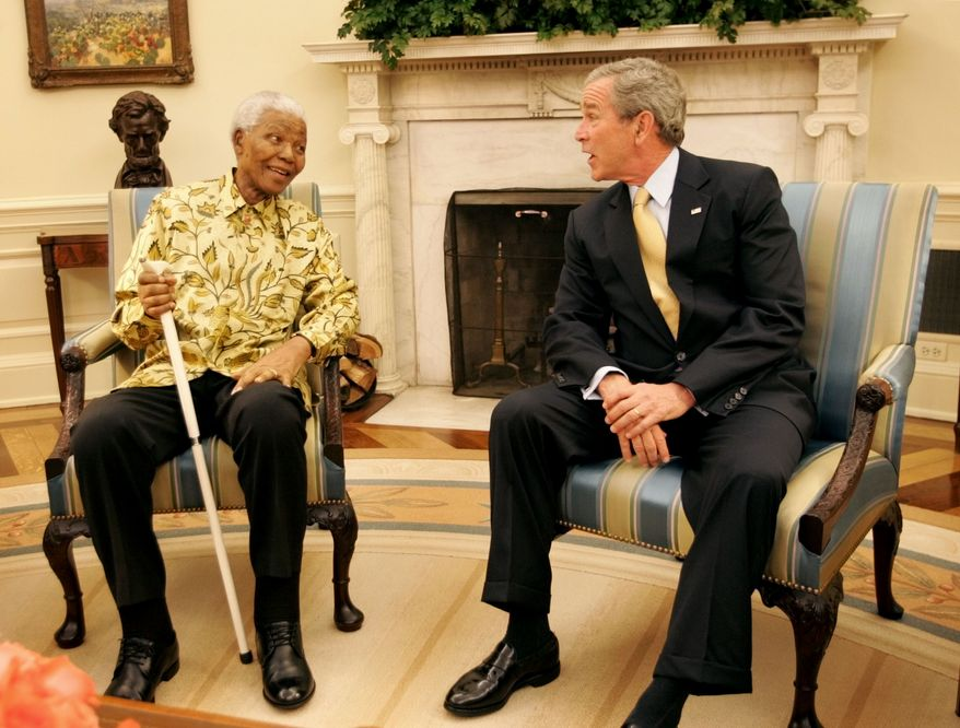 President Bush, right, meets with Former President of South Africa Nelson Mandela, left, in the Oval Office of the White House Tuesday, May 17, 2005, in Washington. Mandela is in the United States seeking support for the Nelson Mandela Legacy Trust, which supports his African-based charities. The Nobel Peace Prize laureate is widely revered for his role in bringing down apartheid in South Africa and leading it to peaceful reconciliation. (AP Photo/Pablo Martinez Monsivais)