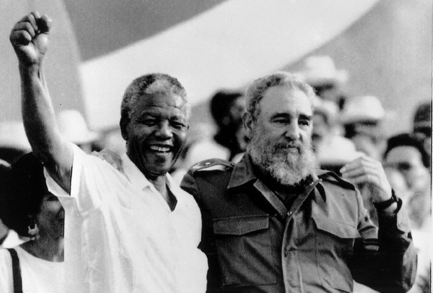 "Cuban President Fidel Castro, right, and African leader Nelson Mandela gesture during the celebration of the ""Day of the Revolution"" in Matanzas Saturday, July 27, 1991. Cubans celebrate 38th anniversary of the revolution. (AP Photo/Alejandro Balaguer)"