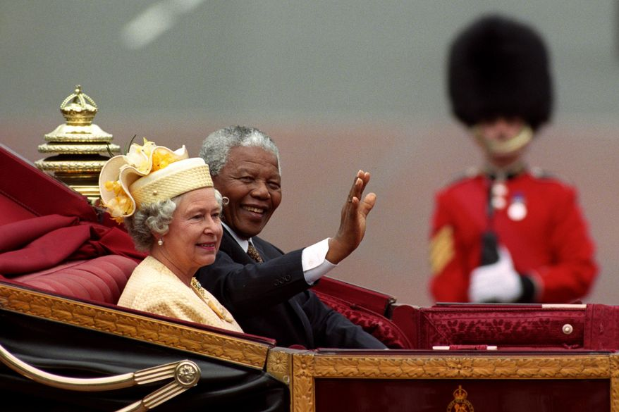 FILE - A July 9, 1996 photo from files of Nelson Mandela, President of South Africa, and Britain's Queen Elizabeth II riding in a carriage along the Mall, London, on the first full day of his state visit to Britain. South African President, Jacob Zuma, announced the death of former South African President Nelson Mandela, aged 95, to the media Thursday evening Dec. 5, 2013, in South Africa. (AP Photo/PA, David Cheskin, File)  UNITED KINGDOM OUT  NO SALES  NO ARCHIVE