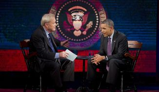 "President Barack Obama talks with MSNBC's Chris Matthews during a break in the taping of an interview for the ""Hardball with Chris Matthews"" show, Thursday, Dec. 5, 2013, at American University in Washington. The show will are later Thursday. (AP Photo/ Evan Vucci)"