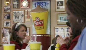 **FILE** Walls full of memorabilia and decorations are seen at the very first Wendy's restaurant in Columbus, Ohio, on March 1, 2007. (Associated Press)