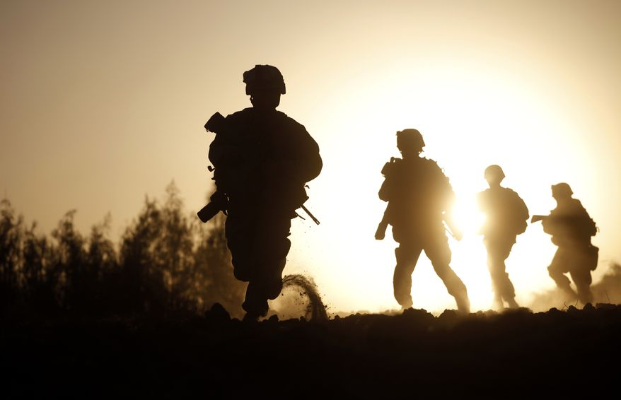 ** FILE ** U.S. Marines with 3rd Platoon, Bravo Company, 1st Battalion 5th Marines, in Nawa district, Helmand province, southern Afghanistan, Oct. 2, 2009. (Associated Press)