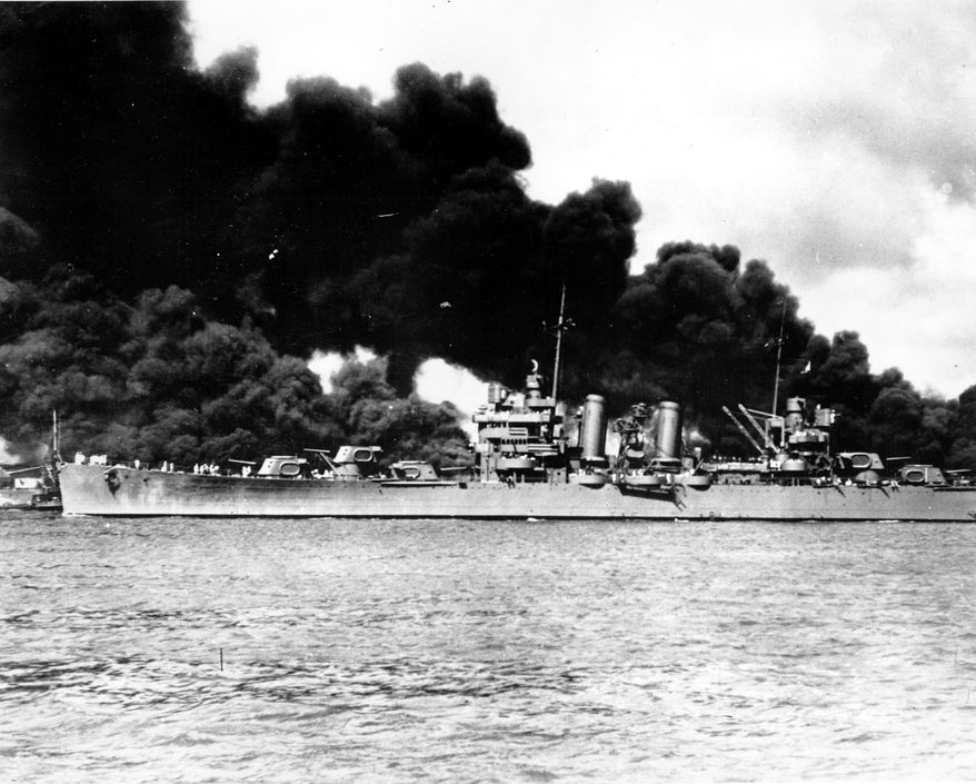 An undamaged light cruiser steams out past the burning USS Arizona and takes to sea with the rest of the fleet during the Japanese aerial attack on Pearl Harbor, Hawaii, on Dec. 7, 1941 during World War II.  (AP Photo/U.S. Navy)