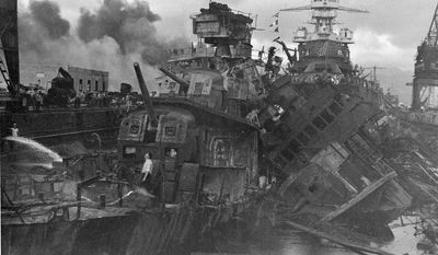 FILE - This Dec. 1941 file photo shows heavy damage to ships stationed at Pearl Harbor after the Japanese attack on the Hawaiian island on Dec. 7, 1941. The most comparable attack against the United States was the surprise Japanese bombing of Pearl Harbor on Dec. 7, 1941, that plunged the U.S. into war. The nation marked the 10-year anniversary of Pearl Harbor much differently than now. Just like the 10-year anniversary of Sept. 11, how the nation experienced the anniversary of Pearl Harbor was shaped by what was happening in the world in 1951. (AP Photo/U.S. Navy)