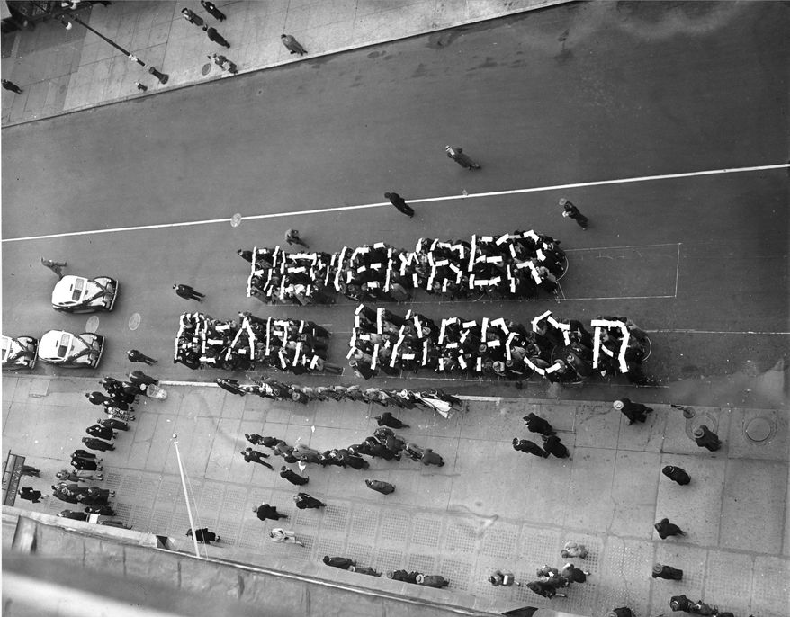 """Members of the Hearns Volunteer National Defense Corps spell the slogan """"Remember Pearl Harbor"""" at a rally held on 14th St. between Fifth and Sixth Avenues in New York City, Dec. 27, 1941.  (AP Photo)"""