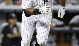 New York Yankees' Curtis Granderson runs towards first base after driving in a run with a single in the eighth inning of a baseball game against the Chicago White Sox at Yankee Stadium, Tuesday, Sept. 3, 2013, in New York. (AP Photo/John Minchillo)