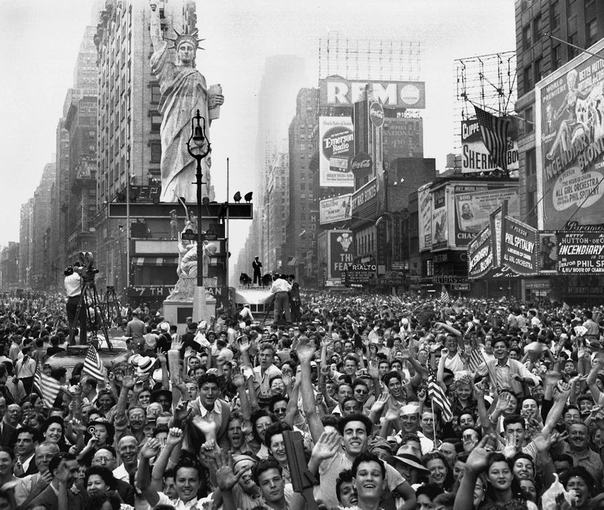Thousands of people celebrate VJ Day on New York's Times Square August 14, 1945 after Japanese radio reported acceptance of the Potsdam declaration. (AP Photo)