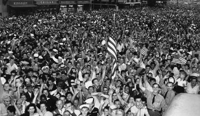Thousands of people celebrate VJ Day as they fill New York's Times Square, Aug. 14, 1945 after Japanese radio reported acceptance of the Potsdam declaration, ending World War II.  (AP Photo/Matty Zimmerman)