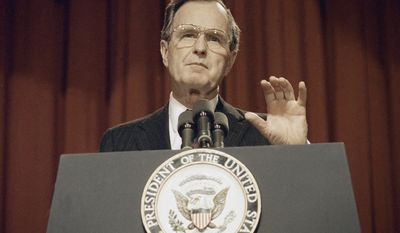President-elect George H. W. Bush gestures while addressing before the personnel advisory committee, Monday, Jan. 9, 1989, Washington, D.C. (AP Photo/Dennis Cook)