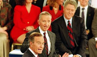 Democratic presidential candidate Bill Clinton, top, and Independent candidate Ross Perot, center, react to Republican candidate President George Bush, foreground, during the second presidential debate at the University of Richmond, Va., Oct. 15, 1992.  (AP Photo/Steve Helber) **FILE**