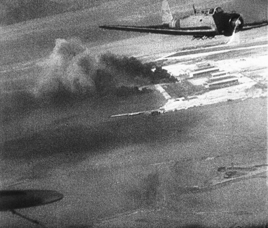 FILE - This Dec. 7, 1941 image provided by the U.S. War Department made from a Japanese newsreel shows Japanese planes over Hawaii during the attack on Pearl Harbor. (AP Photo/U.S. War Department)