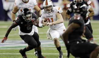 Bowling Green quarterback Matt Johnson (11) scrambles during the second half of an NCAA college football game against Northern Illinois at the Mid-American Conference championship in Detroit, Friday, Dec. 6, 2013. (AP Photo/Carlos Osorio)