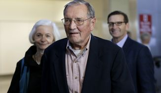 ** FILE ** Merrill Newman, center, walks beside his wife Lee, left, and his son Jeffrey after arriving at San Francisco International Airport on Saturday, Dec. 7, 2013. Newman was detained in North Korea late October at the end of a 10-day trip to North Korea, a visit that came six decades after he oversaw a group of South Korean wartime guerrillas during the 1950-53 war. (AP Photo/Ben Margot)
