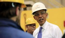 ** FILE ** President Obama tours ArcelorMittal, a steel mill in Cleveland, Nov. 14, 2013. (AP Photo/Pablo Martinez Monsivais)