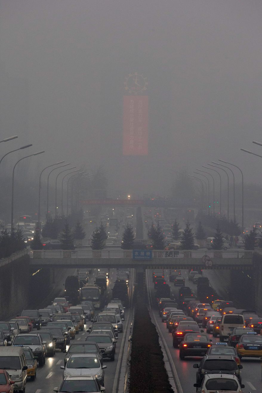 With more than 12 million cars sold in China last year, motor vehicles have emerged as the chief culprit for the throat-choking air pollution in big cities, including Beijing. (ASSOCIATED PRESS)