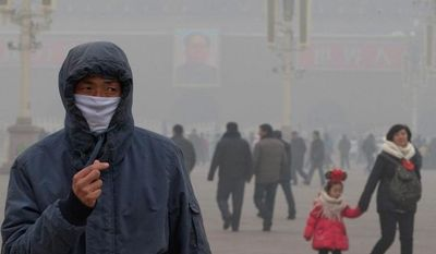 VISIBLE CHANGE: Beijing's Tiananmen Square is filled with smog from industrial emissions. For the past seven years, China has surpassed the U.S. to become the world's biggest emitter of carbon dioxide and other greenhouse gases. (Associated Press)