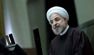"Iranian President Hassan Rouhani says Sunday that the nuclear deal with world powers already has boosted the country's economy. ""They're ready to buy; they have the money now,"" said E.J. Miller, founder of the Iran America Chamber of Commerce. (Office of the president of Iran via Associated Press)"