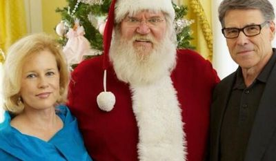 "Texas Gov. Rick Perry, who signed a ""Merry Christmas bill"" into law, and his wife, Anita, feted a king-sized Santa at the governor's mansion Sunday. (GOv. rick perry)"